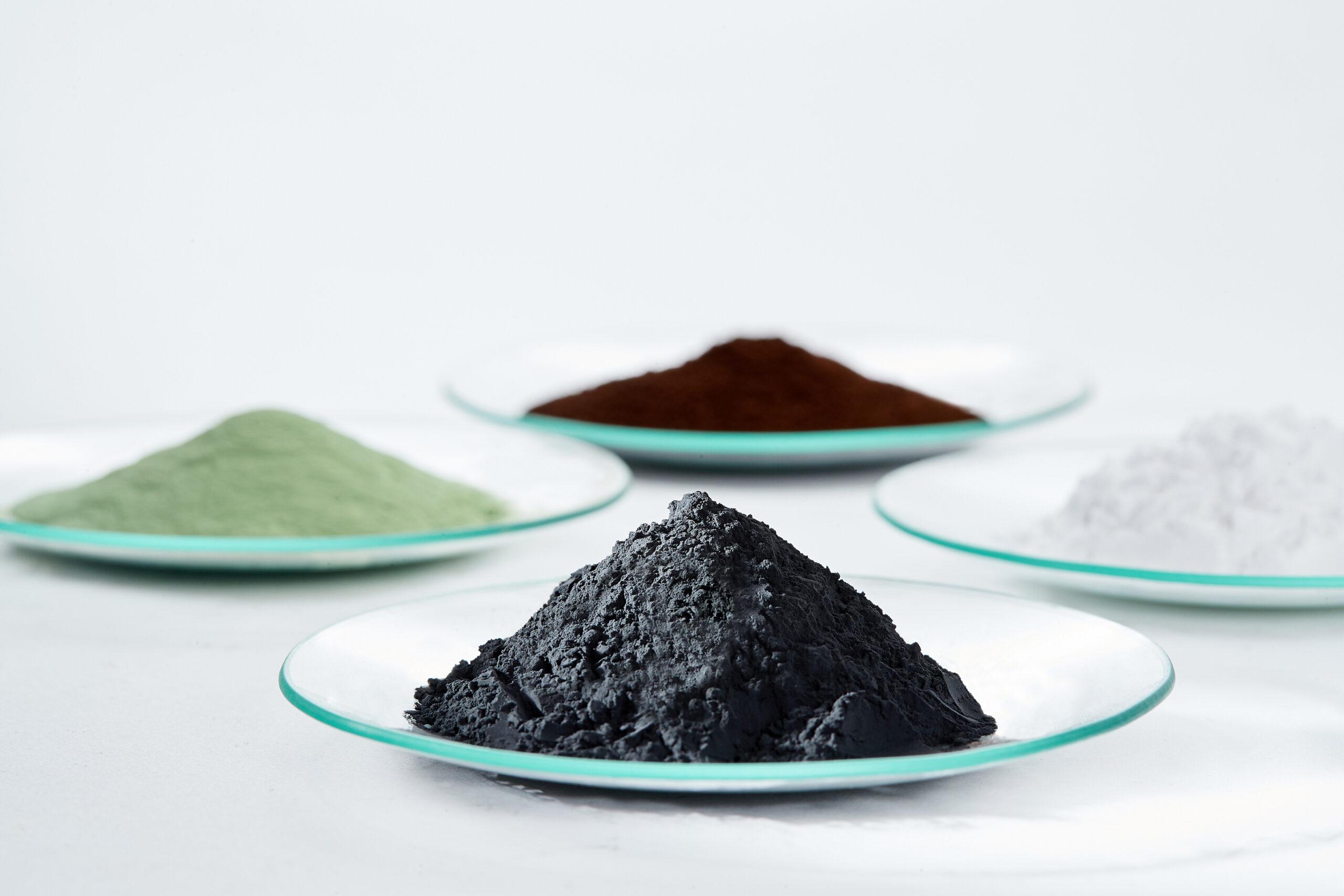 Key to powerful battery materials: Precursor cathode active materials (green and brown powder), lithium carbonate (white powder) and cathode active materials (black powder).